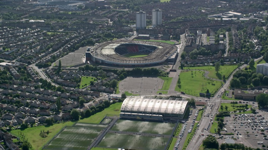 6K stock footage aerial video approach Hampden Park soccer stadium and by houses, Glasgow, Scotland Aerial Stock Footage | AX110_192