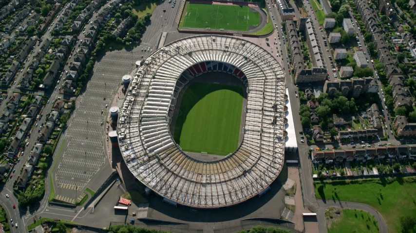 6K stock footage aerial video tilt to bird's eye view of the Hampden Park soccer stadium, Glasgow, Scotland Aerial Stock Footage | AX110_194