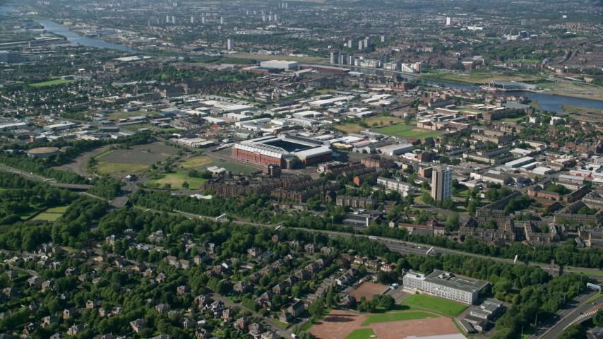 6K stock footage aerial video fly over residential neighborhood toward Ibrox Stadium, Glasgow, Scotland Aerial Stock Footage | AX110_199