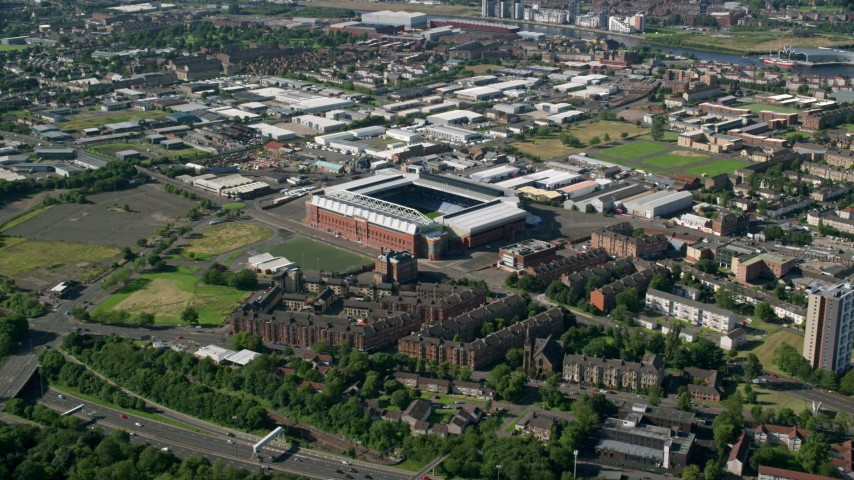 6K stock footage aerial video approach Ibrox Stadium, Glasgow, Scotland Aerial Stock Footage | AX110_200