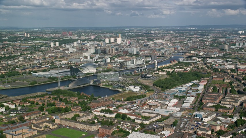 6K stock footage aerial video approach River Clyde near Glasgow Science Centre, Glasgow, Scotland Aerial Stock Footage AX110_203 | Axiom Images