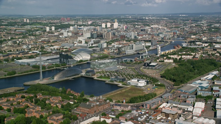 6K stock footage aerial video approach River Clyde, arena and concert hall, Glasgow, Scotland Aerial Stock Footage | AX110_204