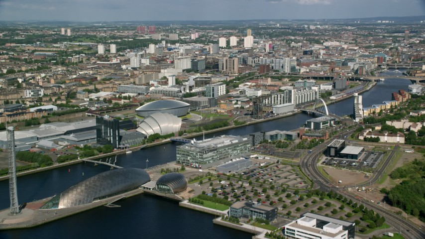 6K stock footage aerial video approach the River Clyde, arena, and concert hall in Glasgow, Scotland Aerial Stock Footage | AX110_205