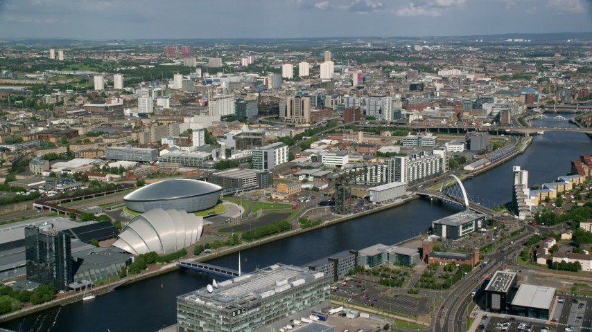 6K stock footage aerial video of River Clyde, arena, concert hall in Glasgow, Scotland Aerial Stock Footage | AX110_206