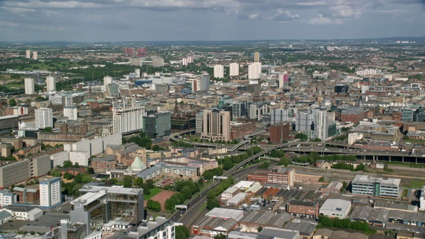 6K stock footage aerial video of approaching city office buildings, Glasgow, Scotland Aerial Stock Footage | AX110_208