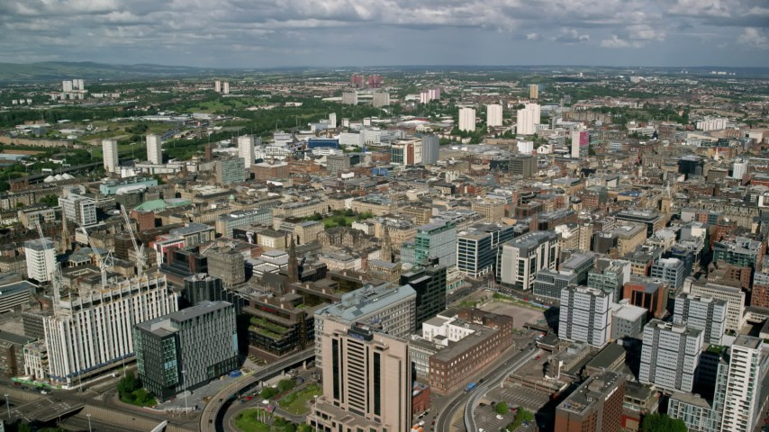 6K stock footage aerial video of office buildings and hotel in Glasgow, Scotland Aerial Stock Footage | AX110_210