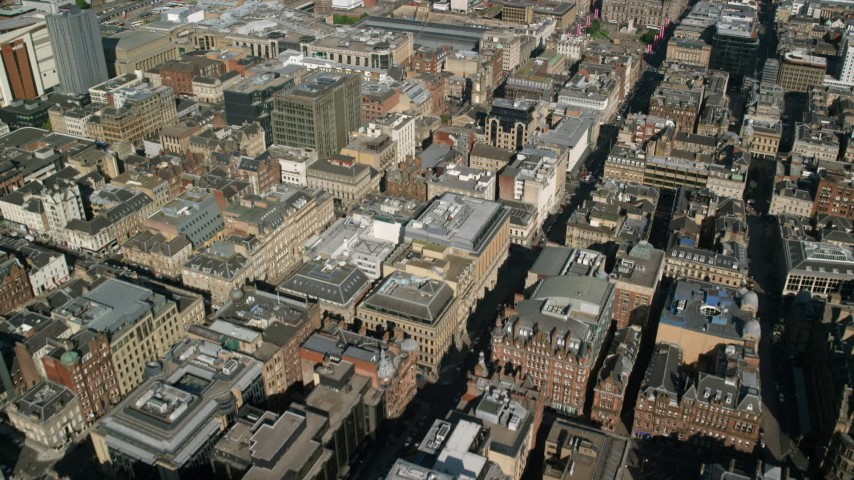 6K stock footage aerial video fly over office buildings and city streets in Glasgow, Scotland Aerial Stock Footage | AX110_211