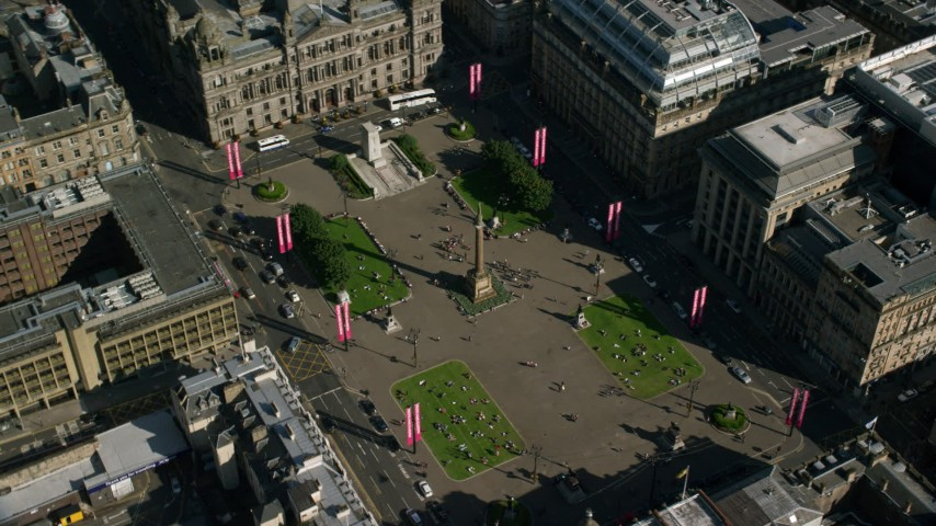 6K stock footage aerial video of George Square and City Chambers, Glasgow, Scotland Aerial Stock Footage | AX110_212