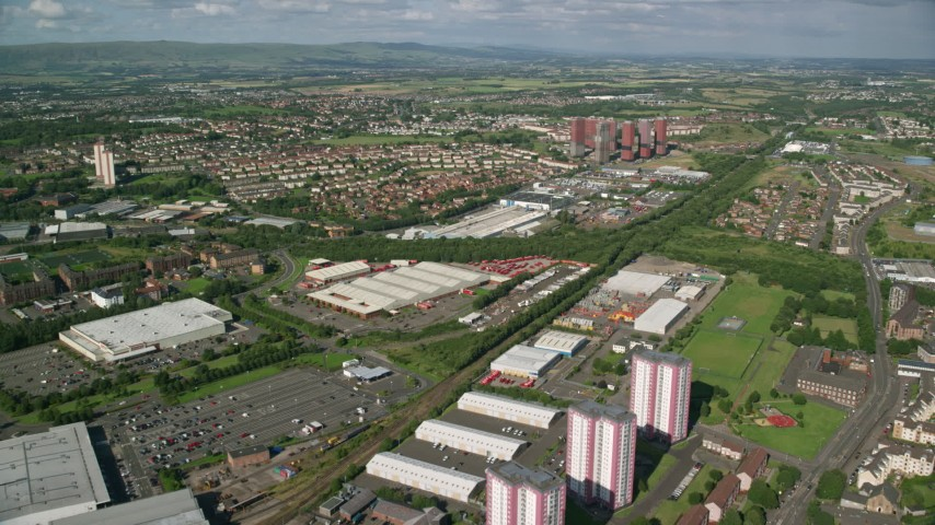 6K stock footage aerial video of apartment buildings and warehouses, Glasgow, Scotland Aerial Stock Footage   AX110_214