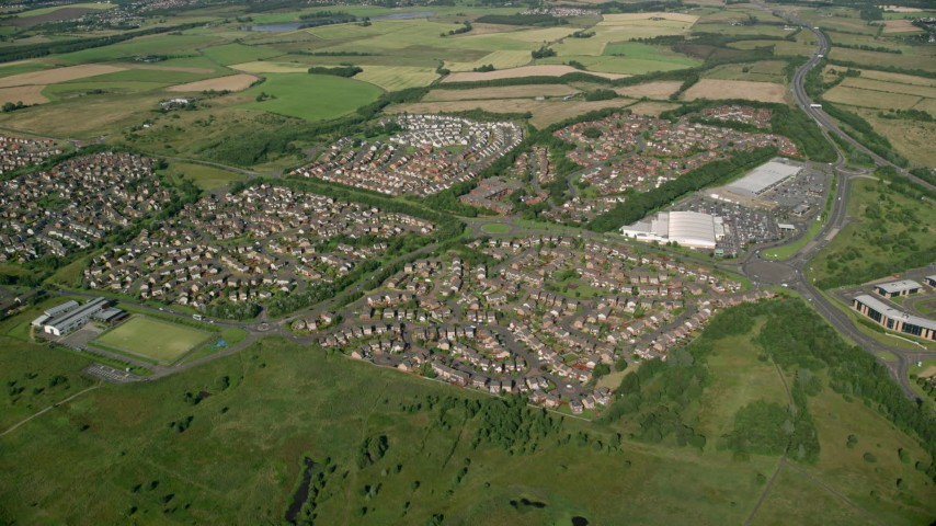 6K stock footage aerial video approach suburban residential homes, Glasgow, Scotland Aerial Stock Footage   AX110_217