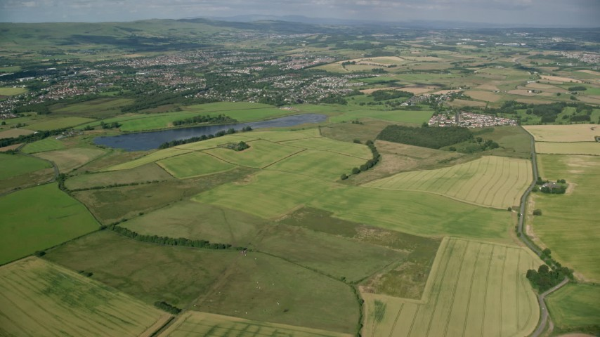 6K stock footage aerial video approach farms, fields, and rural neighborhoods, Glasgow, Scotland Aerial Stock Footage | AX110_219