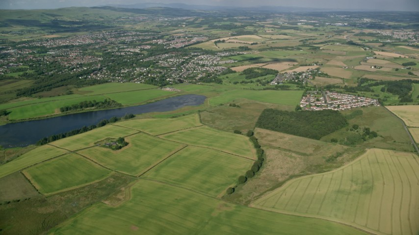 6K stock footage aerial video approach farming fields and rural neighborhoods outside of Glasgow, Scotland Aerial Stock Footage | AX110_220