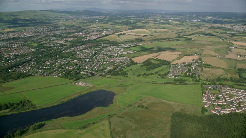 6K stock footage aerial video approach farm fields and rural homes on the outskirts of Glasgow, Scotland Aerial Stock Footage | AX110_221