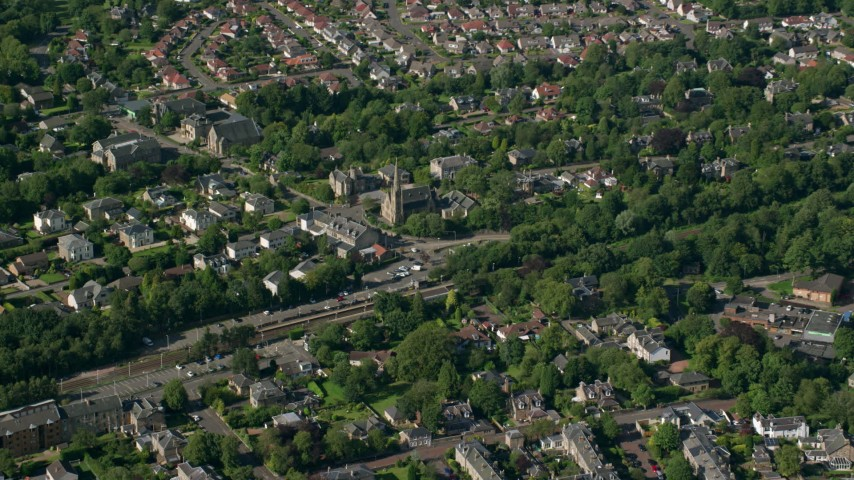 6K stock footage aerial video of a suburban neighborhood and church, Glasgow, Scotland Aerial Stock Footage | AX110_222