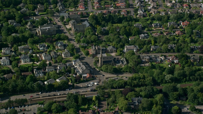 6K stock footage aerial video of orbiting a church in a suburban neighborhood, Glasgow, Scotland Aerial Stock Footage | AX110_223