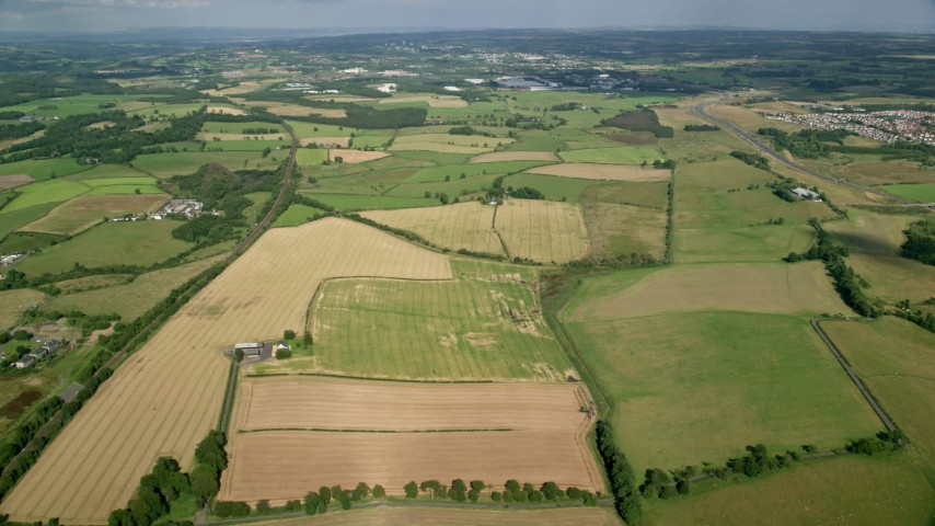 6K stock footage aerial video of farmland on the outskirts of Glasgow, Scotland Aerial Stock Footage | AX110_224