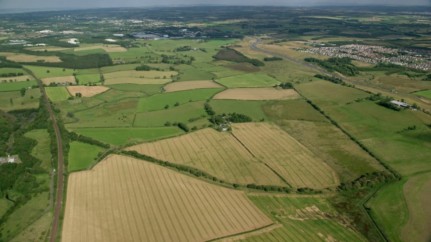 6K stock footage aerial video of fields and farms on the outskirts of Glasgow, Scotland Aerial Stock Footage | AX110_225