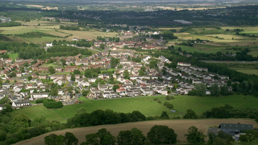 6K stock footage aerial video of rural homes in a village, Bonnybridge, Scotland Aerial Stock Footage | AX110_234