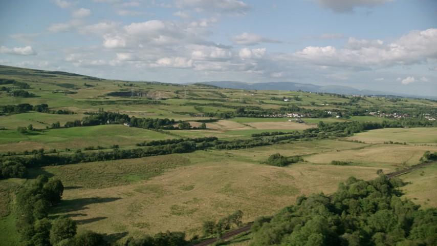 6K stock footage aerial video of green farm fields in a rural landscape, Bonnybridge, Scotland Aerial Stock Footage | AX111_001