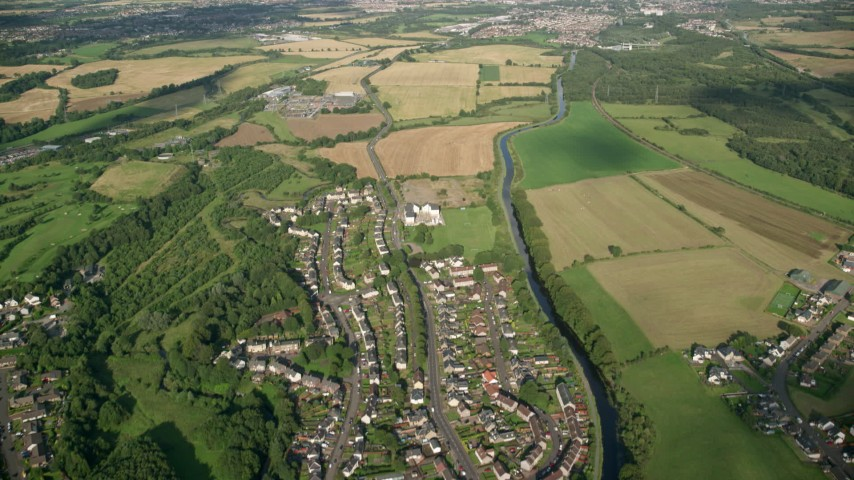 6K stock footage aerial video fly over village homes and farms around a river, Bonnybridge, Scotland Aerial Stock Footage | AX111_004