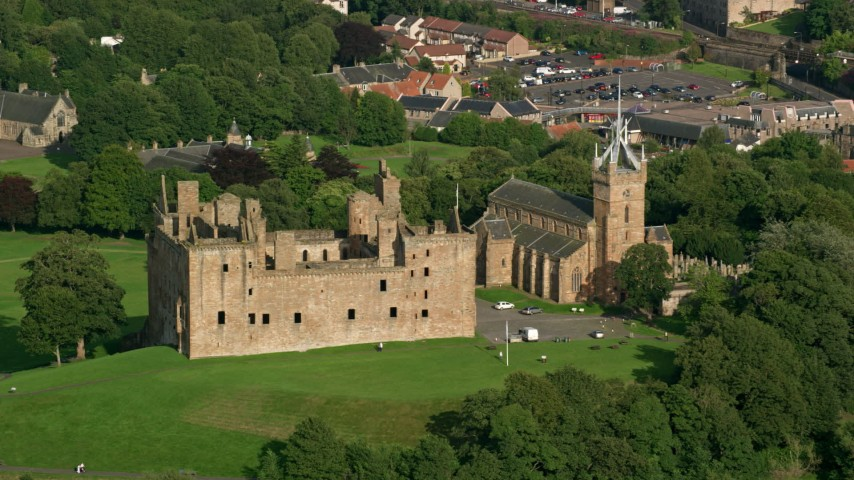 6K stock footage aerial video of Linlithgow Palace and St. Michael's Parish Church, Scotland Aerial Stock Footage | AX111_012