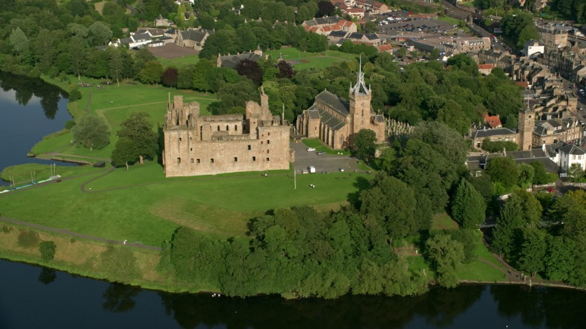 6K stock footage aerial video of iconic Linlithgow Palace and St. Michael's Parish Church, Scotland Aerial Stock Footage | AX111_013