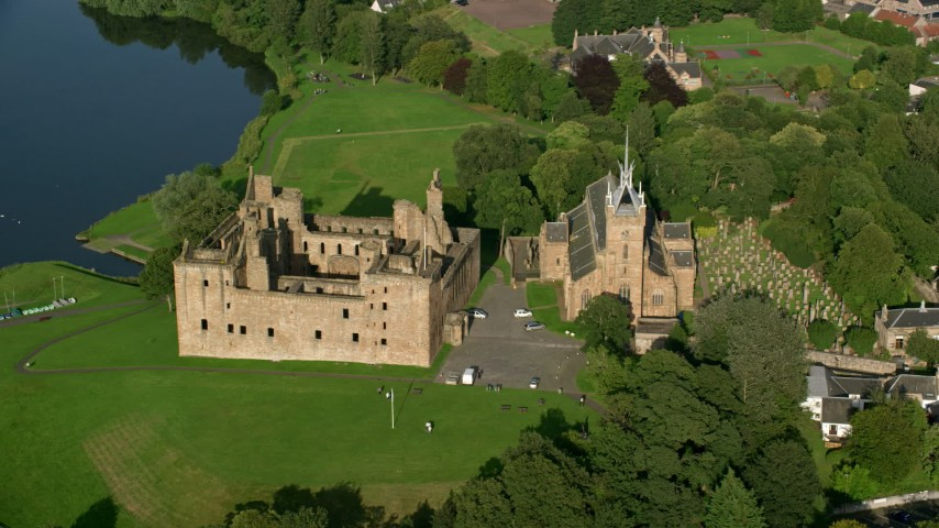 6K stock footage aerial video of orbiting historic Linlithgow Palace and St. Michael's Parish, Scotland Aerial Stock Footage | AX111_014