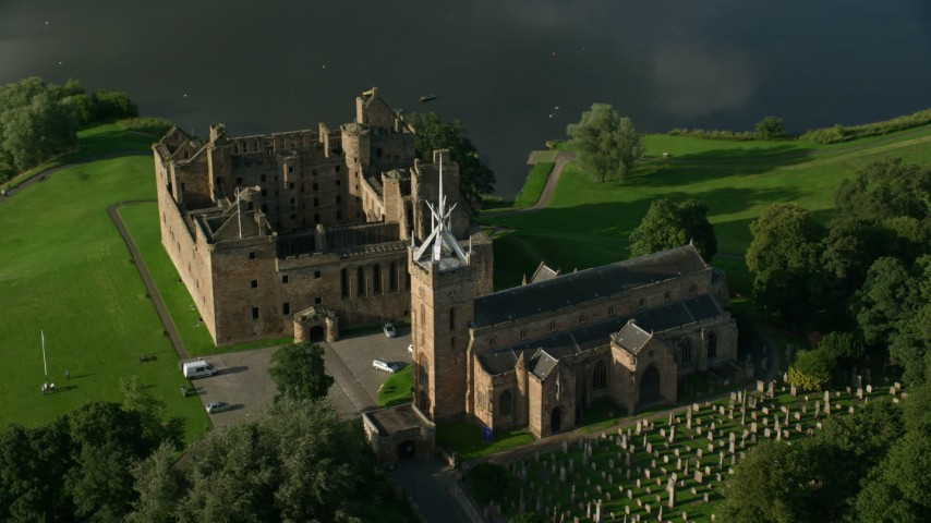 6K stock footage aerial video orbit Linlithgow Palace and the St. Michael's Parish Church, Scotland Aerial Stock Footage | AX111_016