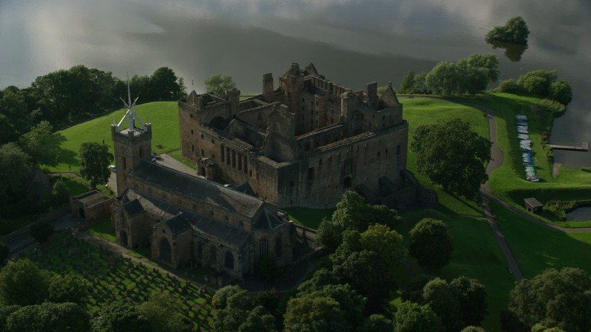 6K stock footage aerial video of historic Linlithgow Palace and St. Michael's Parish church, Scotland Aerial Stock Footage | AX111_017