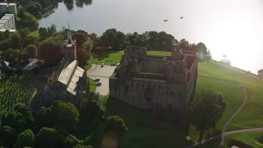6K stock footage aerial video of historic Linlithgow Palace and St. Michael's Parish Church, Scotland Aerial Stock Footage | AX111_018