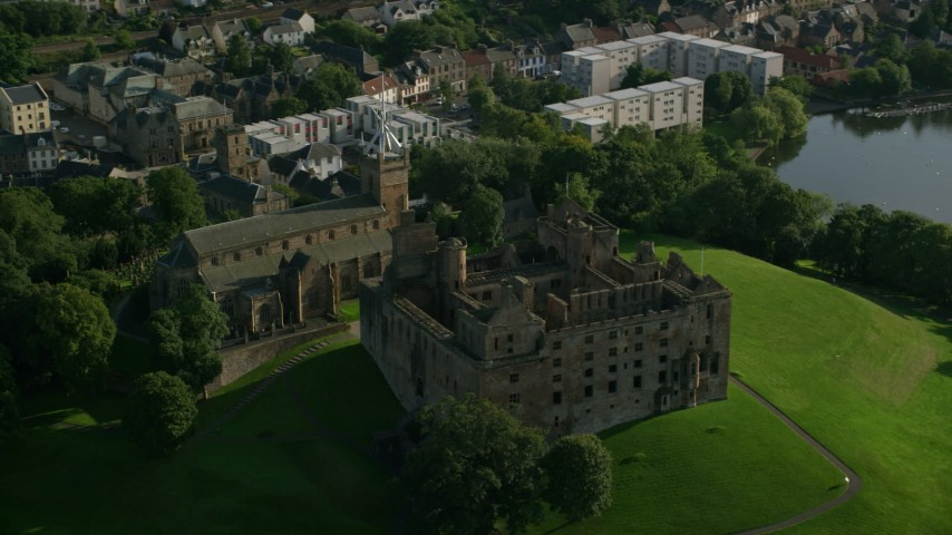 6K stock footage aerial video of the iconic Linlithgow Palace and St. Michael's Parish Church, Linlithgow, Scotland Aerial Stock Footage | AX111_019