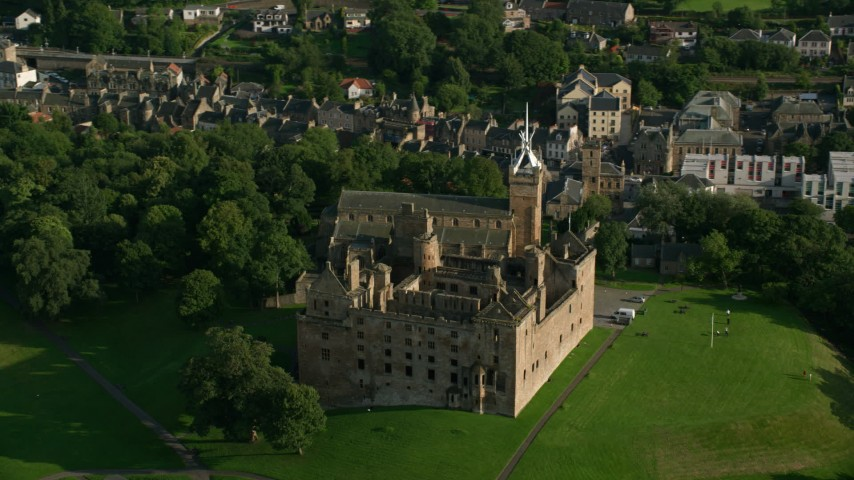 6K stock footage aerial video of an orbit around historic Linlithgow Palace and St. Michael's Parish Church, Linlithgow, Scotland Aerial Stock Footage | AX111_020
