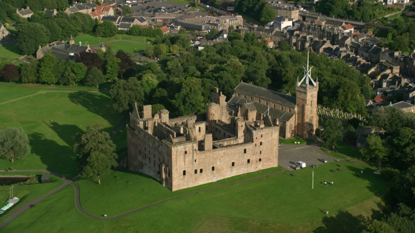 6K stock footage aerial video of circling around iconic Linlithgow Palace and St. Michael's Parish Church, Linlithgow, Scotland Aerial Stock Footage | AX111_021