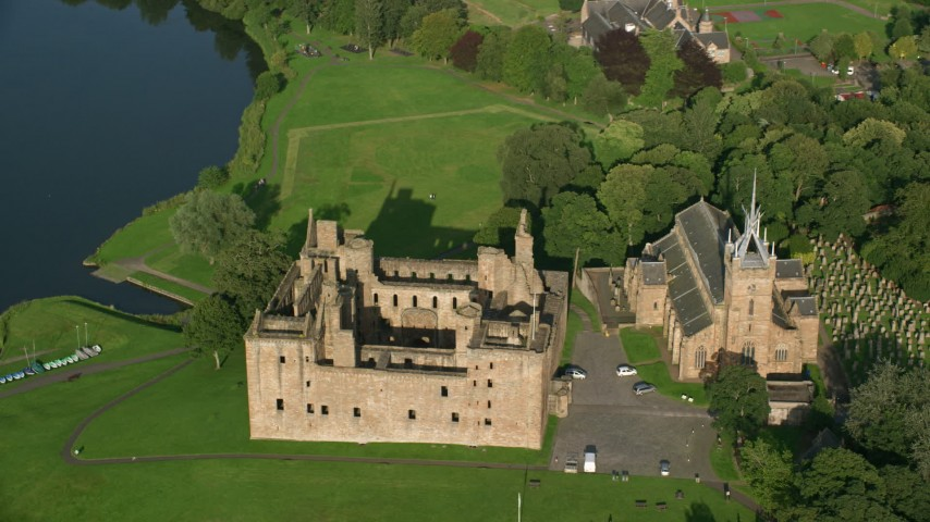 6K stock footage aerial video of historic Linlithgow Palace and St. Michael's Parish Church, Scotland Aerial Stock Footage | AX111_022