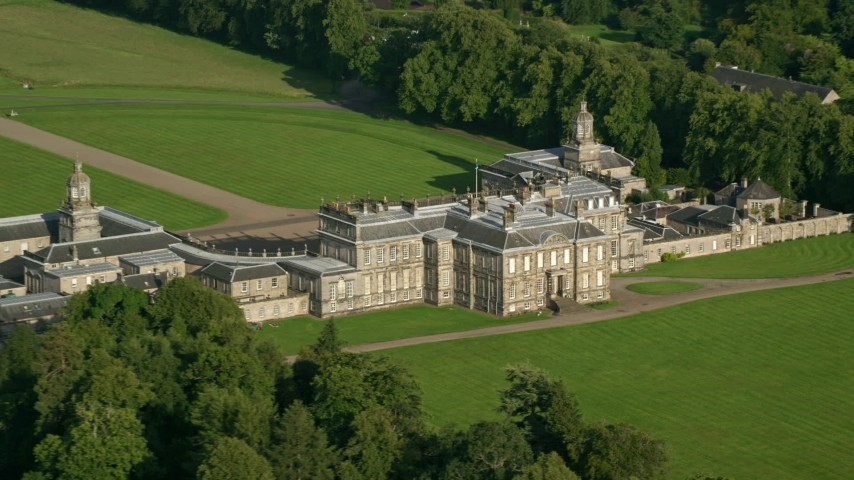 6K stock footage aerial video of zooming to a wider view while passing Hopetoun House, Scotland Aerial Stock Footage | AX111_047