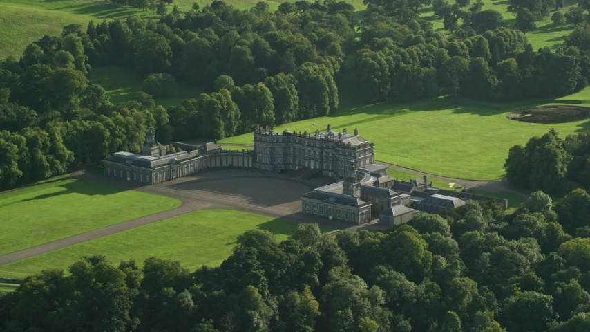 6K stock footage aerial video of flying away from historic Hopetoun House in Scotland Aerial Stock Footage | AX111_050
