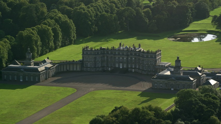 6K stock footage aerial video of passing by Hopetoun House in Scotland Aerial Stock Footage AX111_051 | Axiom Images