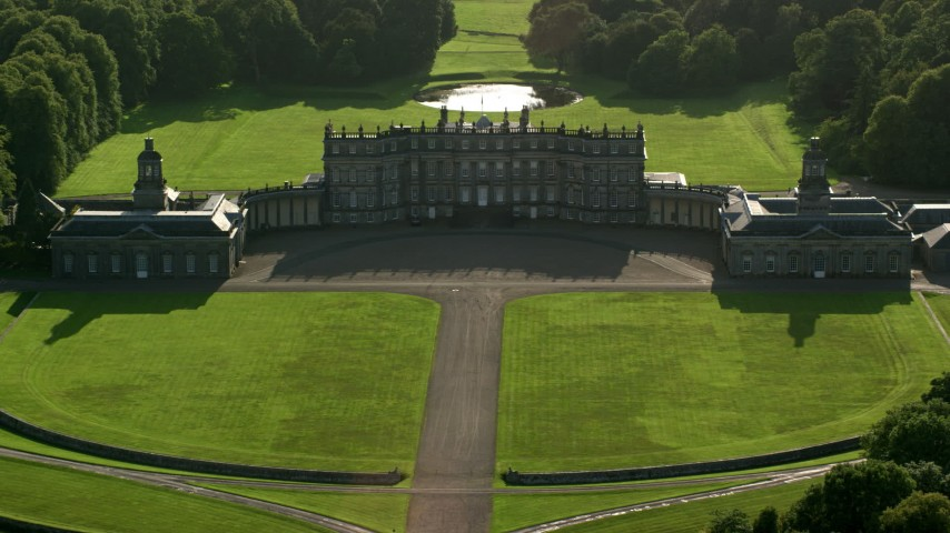 6K stock footage aerial video approach historic Hopetoun House with green lawns in Scotland Aerial Stock Footage | AX111_053