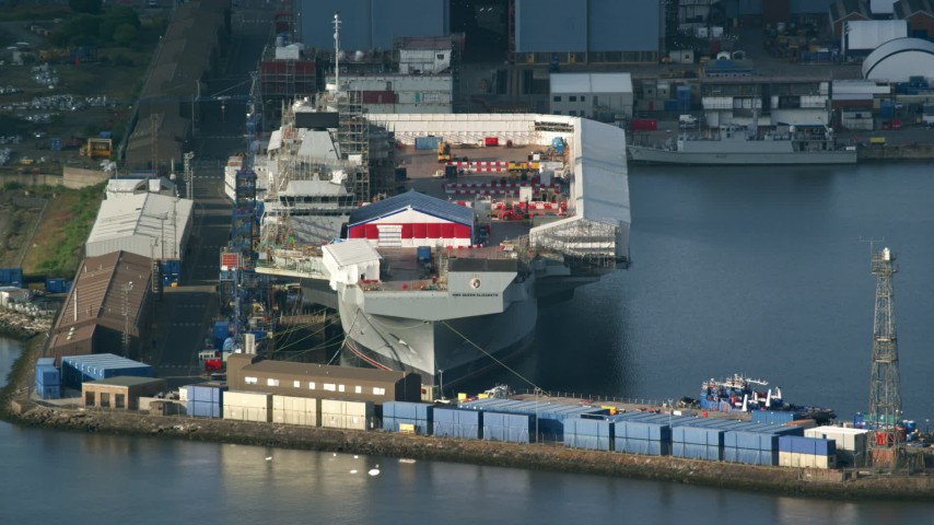6K stock footage aerial video of an aircraft carrier at Rosyth Dockyard on Firth of Forth, Scotland Aerial Stock Footage | AX111_057