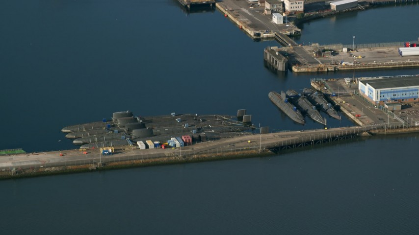 6K stock footage aerial video of submarines at Rosyth Dockyard on Firth of Forth, Scotland Aerial Stock Footage AX111_058 | Axiom Images