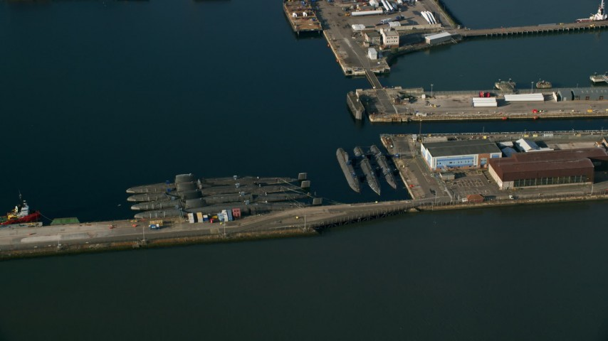 6K stock footage aerial video of submarines at Rosyth Dockyard on Firth of Forth, Scotland Aerial Stock Footage | AX111_060