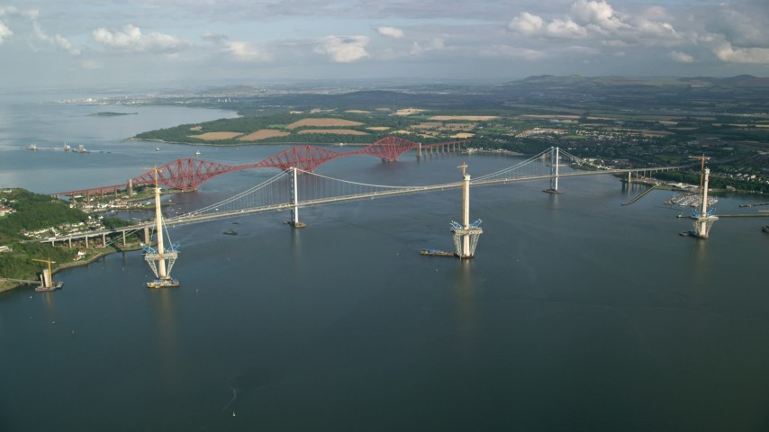 6K stock footage aerial video of Forth Road Bridge and Forth Bridge on Firth of Forth, Scotland Aerial Stock Footage | AX111_061
