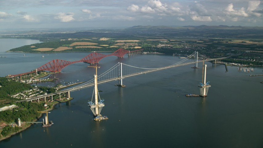 6K stock footage aerial video of a view of the Forth Road Bridge and Forth Bridge on Firth of Forth, Scotland Aerial Stock Footage | AX111_062