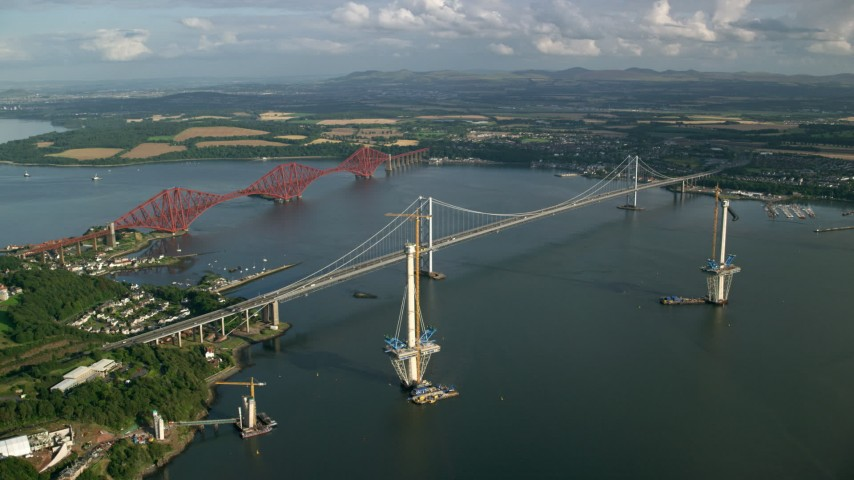 6K stock footage aerial video of flying by Forth Road Bridge and Forth Bridge on Firth of Forth, Scotland Aerial Stock Footage | AX111_063