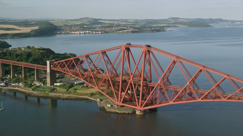 6K stock footage aerial video of the Forth Bridge in North Queensferry, Scotland Aerial Stock Footage | AX111_070