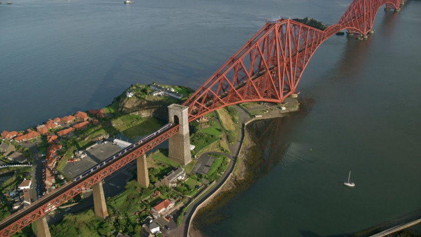 6K stock footage aerial video of a commuter train on Forth Bridge over Firth of Forth, Scotland Aerial Stock Footage | AX111_074