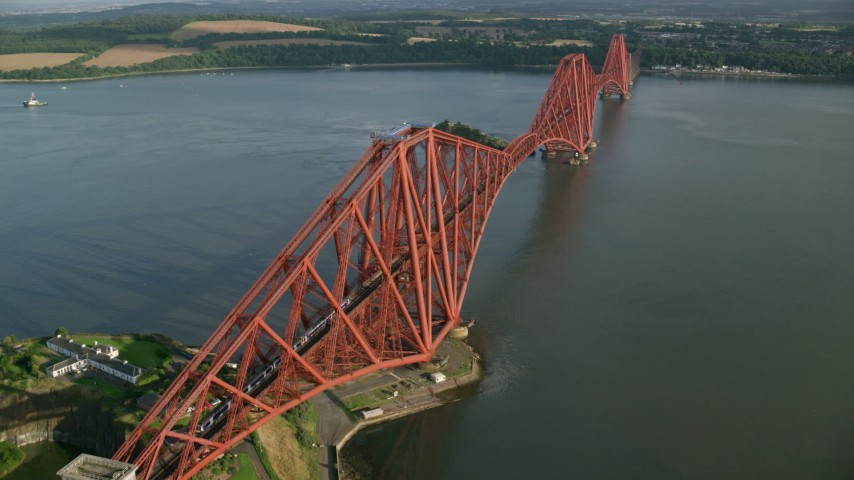 6K stock footage aerial video of tracking a train crossing Forth Bridge over Firth of Forth, Scotland Aerial Stock Footage | AX111_075