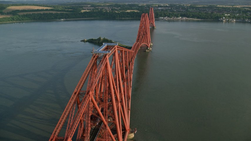 6K stock footage aerial video of tracking a commuter train on Forth Bridge over Firth of Forth, Scotland Aerial Stock Footage | AX111_076