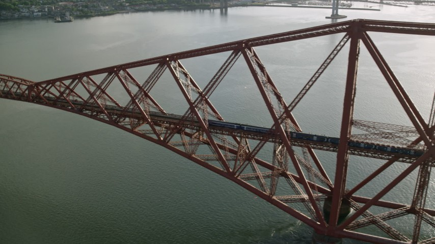 6K stock footage aerial video of tracking a commuter train on Forth Bridge over Firth of Forth, Scotland Aerial Stock Footage | AX111_078