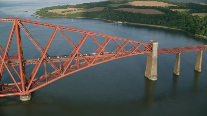 6K stock footage aerial video of a commuter train traveling on Forth Bridge over Firth of Forth, Scotland Aerial Stock Footage | AX111_080